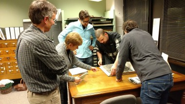 Professers Littell, Millman and Grimm with THC's Donna Eschenbrenner and student Andrew Noyes researching ariel maps